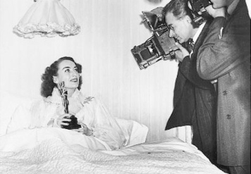 Joan Crawford knows the value of an Oscar!