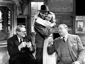 Lionel Barrymore, James Stewart, Jean Arthur, and Edward Arnold in the film of You Can't Take It With You.
